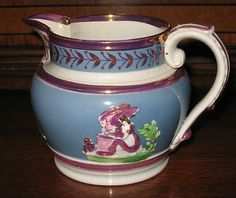 Early 19th century English Pearlware Pink Luster Sprigged Jug with blue in excellent condition.