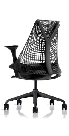 The guest chairs in my office are Herman Miller Sayl chairs.  I like the narrow top, it lets you keep you shoulders back.  Good for your posture.