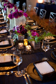 Local flowers and mixed metallic and wood containers make beautiful accents to this romantic runner of black river rock at @Four Seasons Resort The Biltmore Santa Barbara.
