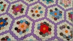 1960's Grandmother's Flower Garden, originally posted on Bonnie Hunter's Open Studio page on facebook. Each flower has yellow or orange center, surrounded by a solid row, surrounded by a scrappy row.