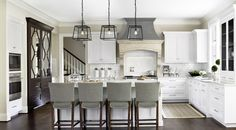 Caden Design Group: Gorgeous L shaped kitchen with white shaker kitchen cabinets paired with marble ...