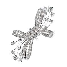 Diamond Bow Brooch in White gold | From a unique collection of vintage brooches at https://www.1stdibs.com/jewelry/brooches/brooches/ #DesignerJewelry