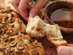 This easy olive-rosemary focaccia requires no kneading or stretching and results in a crisp, olive oil-scented crust and a puffy, moist, well-risen internal crumb with just the right amount of tender chew. #bread #recipe
