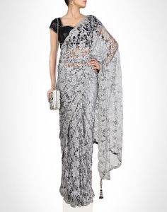 Chantilly lace sari enriched with rhinestones. Shop Now: www.kimaya.in