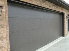 Replace Broken Garage Door Panels By Raleigh Durham Garage Door Experts. Call (844) 334-6727.