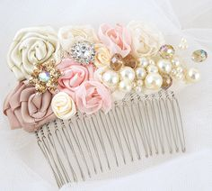 Bridal Hair Comb Fascinator in Blush Pink, Champagne and Ivory with Handmade Satin Flowers, Jewels, Crystals and Czech Pearls. $115,00, via Etsy.