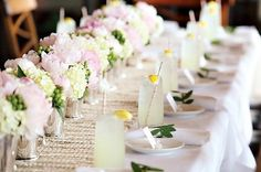 Amanda Kay Brown copy     Sure, one of the centerpieces above might have looked a little meager on this table all by itself. But a whole lineup looks terrific, especially with all of the pretty pink peonies and white hydrangeas.  On top of the woven runner, this is ideal table decor for a vintage wedding or lavish bridal shower.