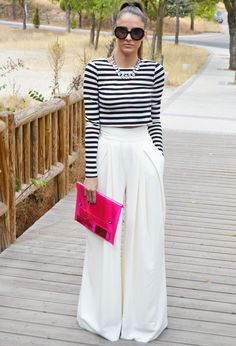Black and white striped cropped shirt, white high-waisted bell bottom pants and bright, bold clutch. Sweet outfit! (36 Great Fall Fashion Combinations)