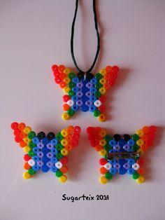 Conjunto de colgante para el cuello y broches mariposa en hama midi. Si te gusta puedes adquirirlo en nuestra tienda on-line: http://www.mistertrufa.net/sugarshop/ Ver más en: http://mistertrufa.net/librecreacion/groups/hama-beads/