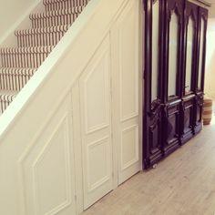 Bijou and Boheme- My basement hallway, under stair storage and laundry sliding doors-