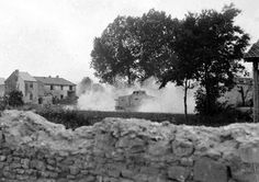 World War I in Photos: Introduction - The Atlantic 34 Western Front, German A7V tanks drive through a village near Rheims in 1918. (National Archive/Official German Photograph of WWI) #