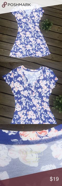 LL Bean V-Neck Floral Blue Coral & White Sun Dress LL Bean V-Neck Floral Blue Coral & White Beach Sun Dress A Line Cotton Casual Pull over, V-neck, gathered waist, short sleeve A-line dress  Perfect for the summer or spring months. A great casual sundress  Preowned, great used condition L.L. Bean Dresses