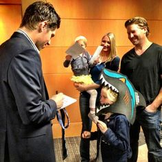 Logan Couture meets with families after the San Jose Sharks' #HockeyFightsCancer Awareness Night.