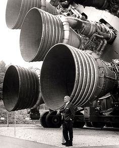 Dr. von Braun stands by the five F-1 engines of the Saturn V Dynamic Test Vehicle on display at the U.S. Space & Rocket Center in Huntsville Alabama. The engines measured 19-feet tall by 12.5-feet at the nozzle exit. 1960s.[2415x3000]