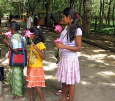 Kataragama, Sri Lanka, girls with temple flowers