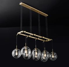 """RH's Languedoc Linear Chandelier 60"""":The character of 1960s French lighting is captured in this chandelier from renowned designer Jonathan Browning. With glass globes suspended from a slender brass frame, the fixture has the appearance of floating in space."""