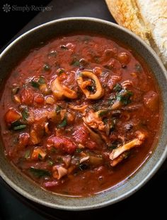 Calamari Stewed with Tomatoes ~ Calamari (squid) slow cooked in tomato sauce with onion, fennel, garlic, red wine, and parsley. ~ SimplyRecipes.com