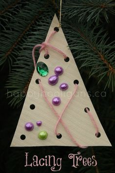 Lacing tree ornaments - an easy Christmas craft for kids to make. Helps to develop sewing and fine motor skills. (happy hooligans)