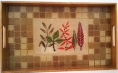 15 x 9x 3/4 serving tray with cross stitch pattern underneath a high shine resin with ceramic tile