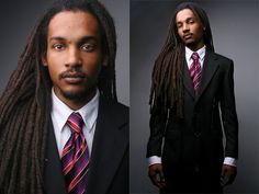 a man in a suit with dreads...