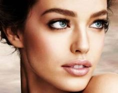 A defined brow, simple eyes and a shimmery lip is a picture-perfect wedding makeup look.