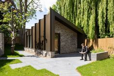 The rehearsal room takes on a more distinct identity, with its bronze wrap and diagonal folded roof. Timber Panelling, Timber Beams, Rehearsal Room, Student Room, London House, Study Areas, Bedroom With Ensuite, Living Environment, House Extensions
