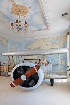 Boy's Bedroom ~ airplane bed, steamer trunks & map wall murals...love the compass on the ceiling!