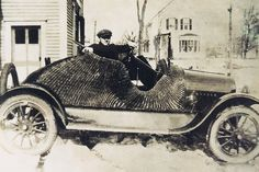 After an accident in the early 1900s, Joseph Poirier repaired his vehicle using sturdy wicker because metal was hard to get. This 1919 photo of Archie shows an ingenious repair that he & my grandpa made on Joseph's car after an accident. Metal parts were scarce, pricey & grandpa was broke as a joke. So the men used their skill && imagination to replace part of the chassis with sturdy wicker. Grandma admired the craftsmanship  & ingenuity but refused to ride in the car.