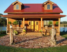 log homes with red metal roof pictures | like the red roof | Corrugated tin and metal
