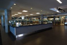 Here's the cafeteria, lovingly referred to as the Deptula-Stygar. Innovative Office, Interior Architecture, Interior Design, Art Deco Buildings, Rustic Contemporary, Retail Space, Stay Cool, Space Furniture, Hardwood Floors