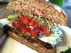 Big Macro Burger, Organic whole-grain brown rice & vegetable burger with lettuce, tomato, pickles, onion, sprouts, soy cheese, and special sauce on a fresh-baked whole wheat bun, Photo: http://www.thedeliciouslife.com/m-cafe-de-chaya-macro/