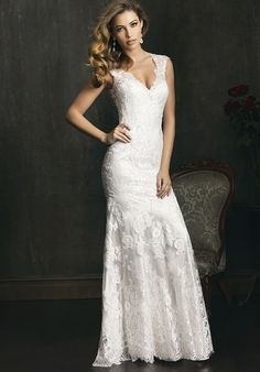 A sexy and sophisticated style in all-over lace.  This slim gown features a v-shaped neckline with delicate, cap sleeves.  The true beauty of this style is the dramatic back.  While the entire back is covered in sheer lace for coverage, the low back is beautifully shaped for the finishing touch.