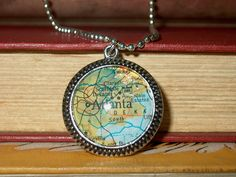 Vintage Book Jewelry - Upcycled Book Art Pendant Featuring City Map of Atlanta GA. $30.00, via Etsy.