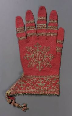 Knitted red silk and gilt-silver yarns, edged with gilt-silver lace. Bands on fingers, monogram IHS on back, band at wrist. Cuff lined with pink silk. Tassel depending from cuff edge. Medieval Clothing, Antique Clothing, Historical Costume, Historical Clothing, 1500s Fashion, Costume Renaissance, 16th Century Fashion, Pink Silk, Red Silk