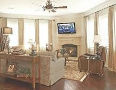 how to arrange furniture with a corner fireplace.