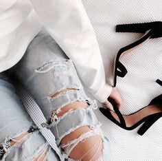 destroyed denim and black heels