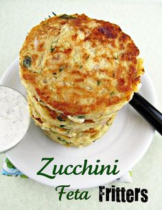 Zucchini fritters with a compelling Greek twist! Hunks of feta cheese and fresh herbs liven up these fritters made with shredded zucchini, egg and flour. A cucumber lemon yogurt sauce shocks them with cool and bright flavor.