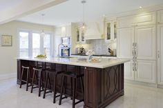 Kitchen White Cabinets with Wood Island :: Traditional Kitchen by ATD Contracting Services Inc.