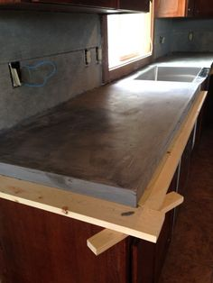 Kitchen Countertops DIY Concrete Counters Poured over Laminate! - DIY Concrete Counters Poured over Laminate - how we poured concrete over our laminate counters so we could install our stainless steel apron front sink. Diy Concrete Countertops, Outdoor Kitchen Countertops, Concrete Cement, Diy Counters, Bathroom Countertops, Concrete Floors, Concrete Counter Tops Kitchen, Concrete Cost, Modern Countertops