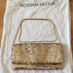 Sequined detachable clutch/ bag Gold sequenced detachable clutch/ purse/ bag in great condition. BCBGMaxAzria Bags