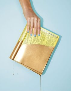art direction   gold dipped phone book