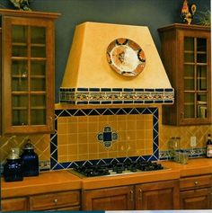 Solid color mural with central blue/white design, framed with contrasting color tiles.   Mexican Kitchen Design, Pictures, Remodel, Decor and Ideas - page 4