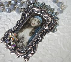 absolutely love this Victorian stamping from B'sueboutique.com. This boho gypsy girl image is so haunting. She is strung with Czech crystals and embellished with vintage rhinestones. I think there will more in my future.