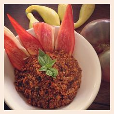 Raw Chilli for winter  Low Fat Raw Vegan Chili  -1-2 lrg tomatos (we used an heirloom)  -3 med. sized carrots  -3 stalks celery  -1 green bell peppers  -1 medium zucchini  -1/2 white onion  -1 inch piece of minced ginger  -4-6 dates  -1/4 cup dulse  -1 fresh sage leaf  -1 sprig oregano  -4-6 fresh basil leaves  -1/2 tbs cumin  -1/2 tbs paprika  -1/2 lime juiced