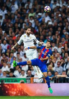 917934993ff1ee Sergio Ramos of Real Madrid CF competes for the ball with Luis Suarez of FC  Barcelona