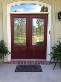 Refinished fiberglass door with 2 coats Annie Sloan chalk paint in Primer Red & clear wax, then dark wax.