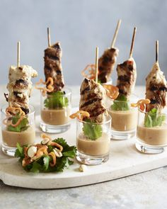 Bid adieu to the old and welcome the new. These spicy and sweet chicken skewers will melt in your mouth with flavor, and you'll want to put this peanut sauce on everything! Individual Appetizers, Meat Appetizers, Appetizer Recipes, Shot Glass Appetizers, Appetizer Buffet, Party Food Platters, Canape Food, Party Food Buffet, Spicy Peanut Sauce