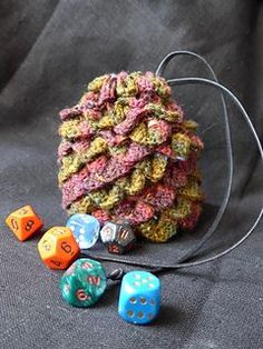 This little dice bag looks like a dragon egg complete with dragon scales.