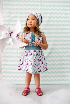 Janel Anderson's Nohi Kids' organic cotton, bamboo viscose sportswear is colored in sophisticated yet happy tones and printed with patterns kids can connect to. Here, dusty blue and plum and a shape-making gathered waistband take the spring-summer 2014 pony print dress from school to dinner. www.nohikids.com (designer's preview)