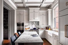 **** great kitchen plan, like the mix of white & grey, change the marble counters (quartz, soapstone?) and backsplash, add shelf over stove, microwave instead of top oven, switch brass hardware to silver or bronze